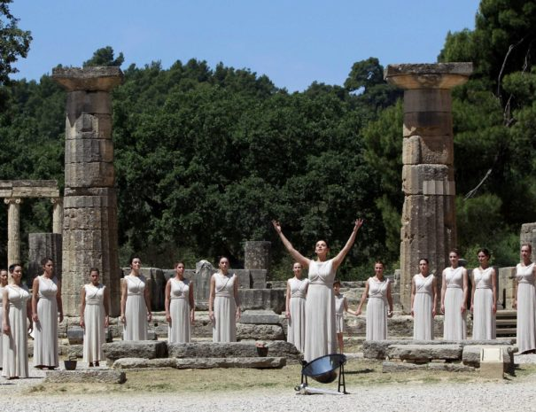 Greek actress Ino Menegaki (C), playing the role of High Priestess, prepares to light the Olympic Flame during a dress rehearsal for the London 2012 Olympic Games at the site of ancient Olympia in Greece May 9, 2012. The official lighting ceremony for the London Games will take place on May 10. REUTERS/John Kolesidis (GREECE  - Tags: SPORT OLYMPICS)
